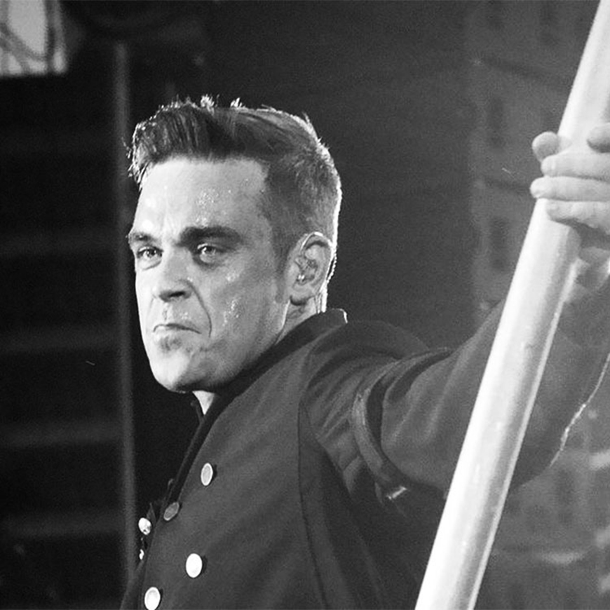 content marketing image of Robbie williams